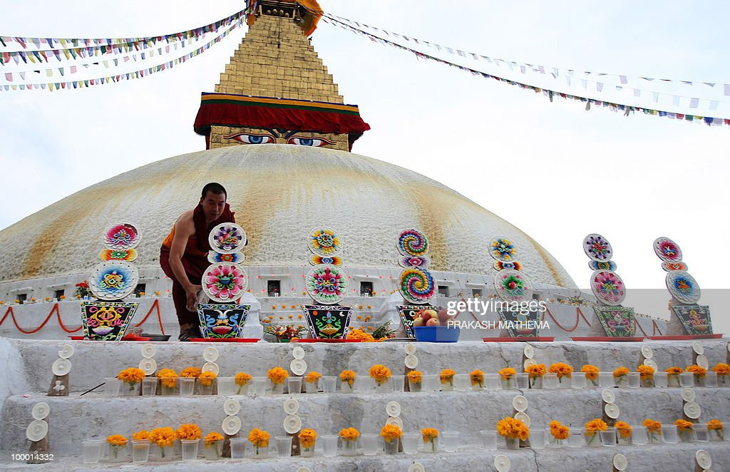 Nepalese and Exile Tibetan monks attend a prayer meeting marking the Buddha�s birthday at Bauddha in Kathmandu on May 20, 2010. Hundreds of Tibetan monks celebrated Buddha�s birthday offering flowers and fruits. AFP PHOTO/Prakash MATHEMA