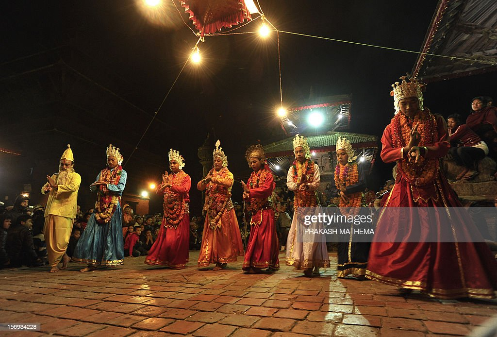 Nepalese artists perform traditional dances locally known as 'Kartik Naach' in Lalitpur, on the outskirts of Kathmandu, on November 25, 2012. The religious dance performance is part of a series of dances taking place over eight days during the 'Kartik' period of the Nepali calendar and which serve as a thanks giving ceremony for Lord Kumara and the protection he brings. AFP PHOTO / Prakash MATHEMA