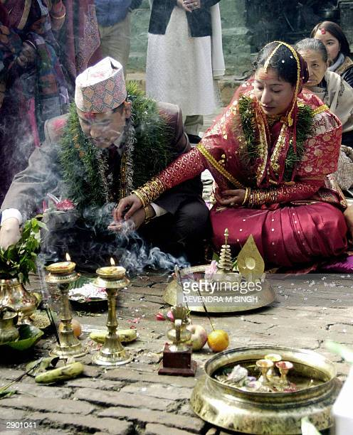 Nepalese bride and a groom perform their wedding rituals according to Nepalese Hindu traditions on the occasion of Basant Panchami in Kathmandu 26...