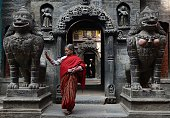A Nepalese Buddhist devotee leaves after offering prayers at the Golden Temple near Patan Durbar square in Lalitpur about five kilometers southeast...