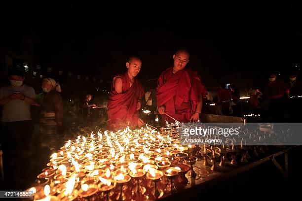 Nepalese Buddhist devotees light candles during the Buddha Purnima or Buddha Jayanti a Buddhist festival marking Gautama Buddha's birth at the...
