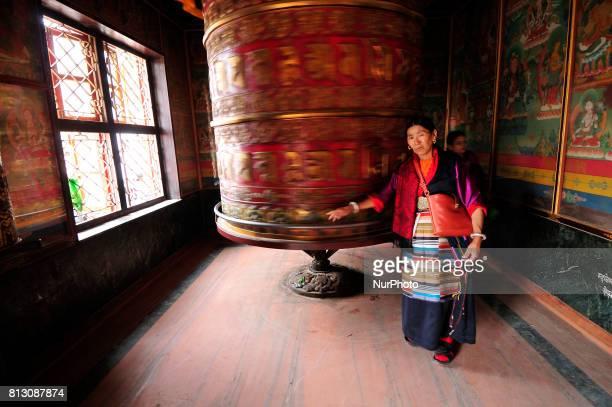 A Nepalese Buddhist offering kora around big prayer wheel at Boudhanath Stupa Kathmandu Nepal on Tuesday July 11 2017 Boudhanath Stupa is listed as a...
