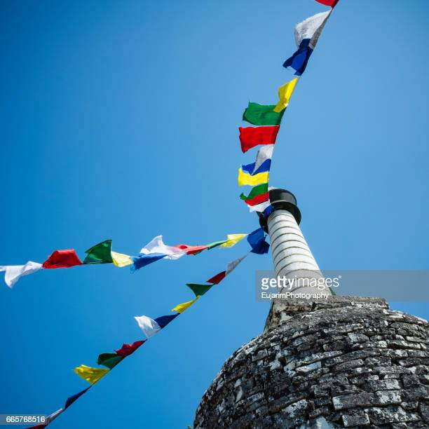 Nepalese buddhist tower(stupa) decorated with multi-colored prayer flags