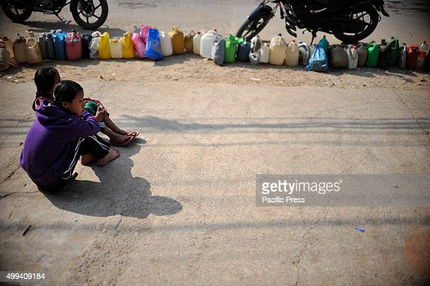 Nepalese children stay in a queue for Kerosene from early morning at Kirtipur For the past few months neighboring India has blocked the...