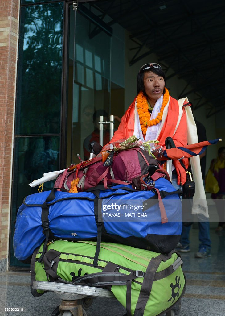 Nepalese climber Phurba Tenjing Sherpa arrives at an airport in Kathmandu on May 24, 2016, after he successfully summitted Mount Everest for the tenth time. Rescuers searching for two Indian climbers missing on Mount Everest said that there was little hope of finding the pair alive after losing contact with them over the weekend. The two men -- identified by the Indian embassy as Paresh Nath and Goutam Ghosh -- were near the summit of the 8,848-metre (29,029-foot) mountain on May 21, when they lost contact with the rest of their team. MATHEMA