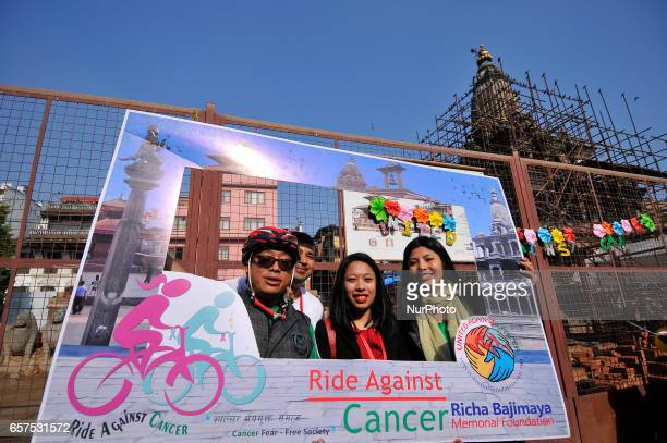 Nepalese cyclist participant takes a picture on a photo booth on a 'Ride Against Cancer' is an annual event organized by Richa Bajimaya Memorial...