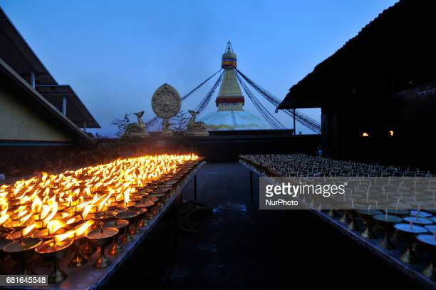 Nepalese devotee offered butter lamps at the premises of Boudhanath Stupa during celebration the 2561 Buddha Purnima festival Birth Anniversary of...