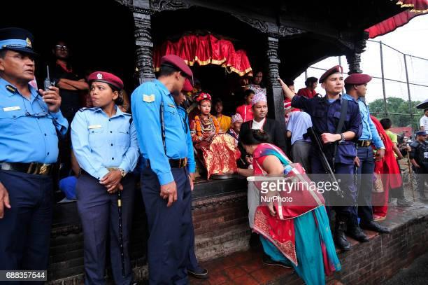 Nepalese devotee offering ritual prayer towards Living Goddess of Patan Unikia Bajracharya during Bhoto Jatra festival at Jawalakhel Patan Nepal on...