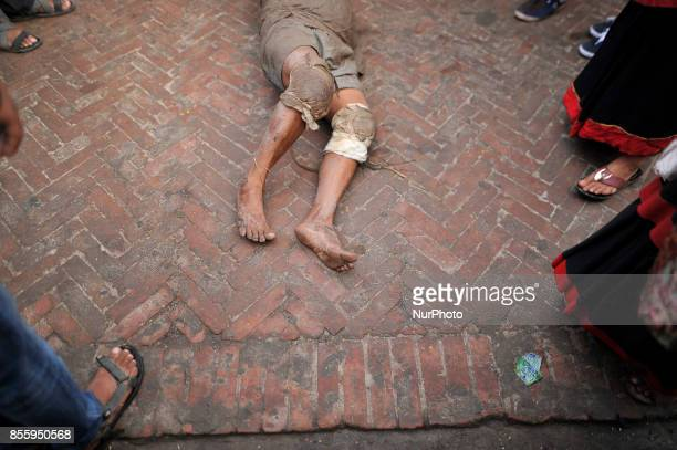 A Nepalese devotee roll on a ground to offer ritual prayer during the tenth day of Dashain Durga Puja Festival in Bramayani Temple Bhaktapur Nepal on...