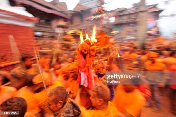 Nepalese devotees carrying torch frame during the celebration of quotSindoor Jatraquot vermillion powder festival or Nepalese New Year day...