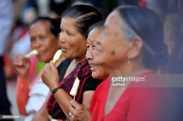 Nepalese Devotees eats icecream as awaits the last day of chariot pulling festival of Rato Machindranath 'God of Rain' at Kumaripati Patan Nepal on...