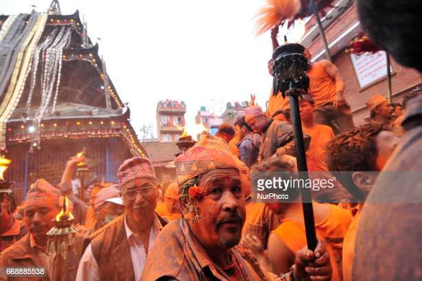 Nepalese devotees holds torch frame during the celebration of quotSindoor Jatraquot vermillion powder festival or Nepalese New Year day celebration...