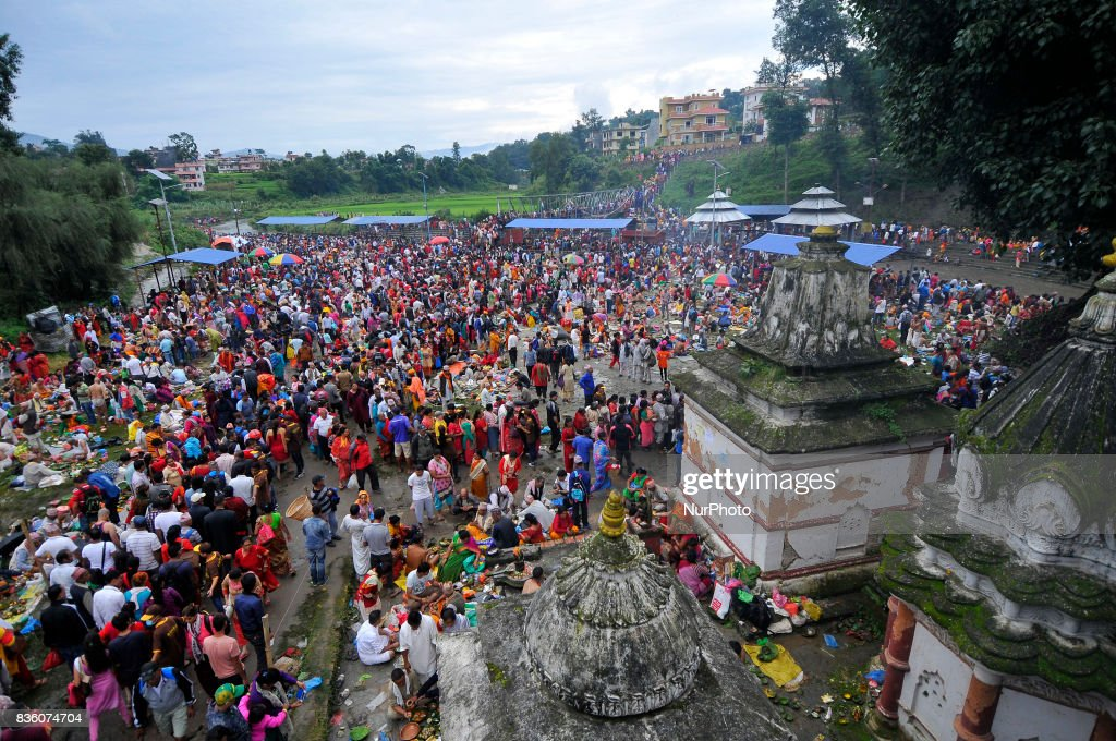 Nepalese devotees lining outside Gokarna Temple for Religious Ritual Puja during the celebration of Kuse Aunsi or Father's Day at Gokarna Temple in Kathmandu, Nepal on Monday, August 21, 2017. On the day of the new moon, families also pay their respects to their deceased fathers.