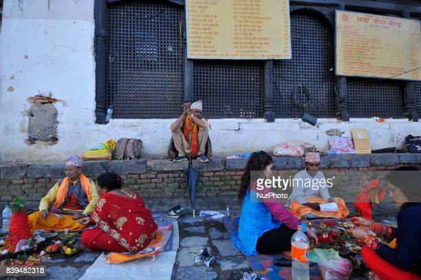 Nepalese devotees offering ritual prayer at the Bank of Bagmati River of Pashupatinath Temple during Rishi Panchami Festival celebrations at...