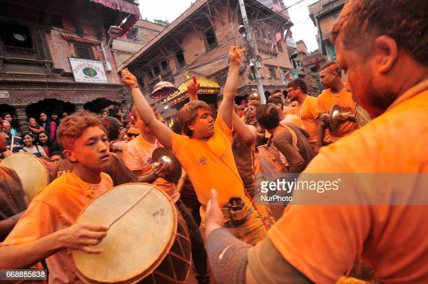 Nepalese Devotees playing traditional instrument during celebration of quotSindoor Jatraquot vermillion powder festival as Nepalese New Year day...