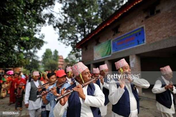 Nepalese devotees plays traditional instruments during the tenth day of Dashain Durga Puja Festival in Bramayani Temple Bhaktapur Nepal on September...