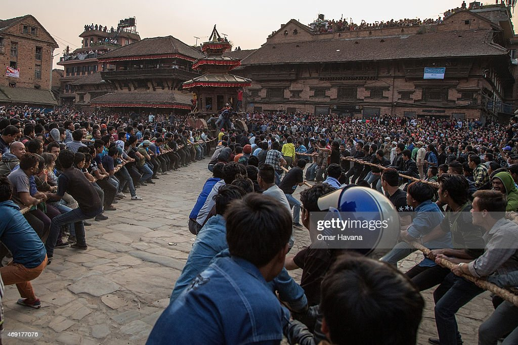Nepalese devotees pull a wooden chariot on the first day of the Bisket Jatra festival on April 10 2015 in Bhaktapur Nepal The Bisket Jatra festival...