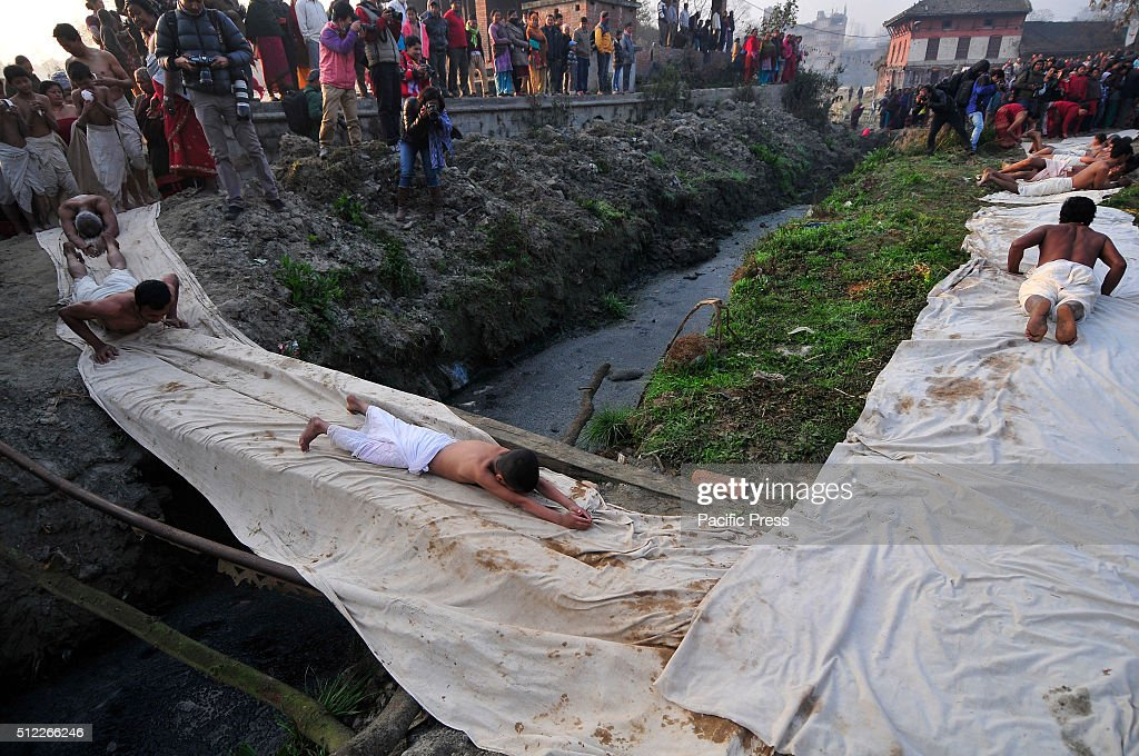 Nepalese devotees roll on the ground during last day of a
