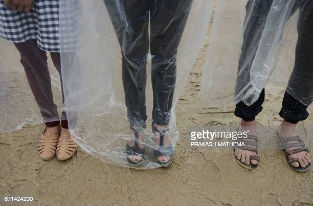 Nepalese environmental activists take part in a protest to mark Earth Day by covering themselves in plastic sheets to protest against air pollution...