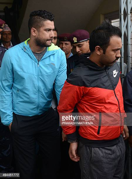 Nepalese footballers Anjan KC and Bikash Singh Chhetri are escorted by security personnel from a Special Court in Kathmandu on October 27 2015 The...