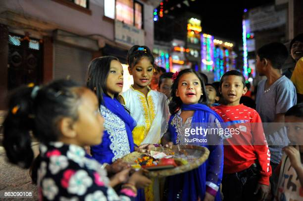 Nepalese girl singing traditional songs during Laxmi Puja as the procession of Tihar or Deepawali and Diwali celebrations at Kathmandu Nepal on...