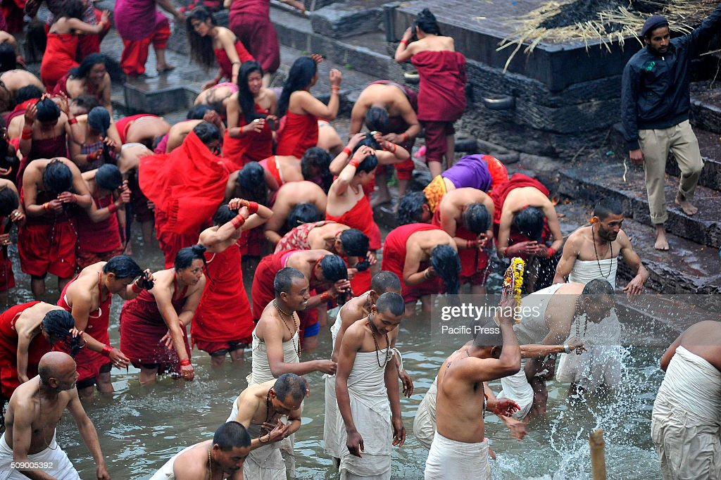 Nepalese Hindu carries the idol Madhav Narayan for a ritual during the holy bath in Pashupathnath Temple. Nepalese Hindu women fast and pray to Goddess Swasthani for Long life of their husbands and family prosperity during the month-long fasting festival celebration.