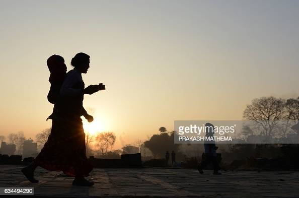 Nepalese Hindu devotee arrives for prayers on the last day of the monthlong Swasthani Festival in the Hanumante River at Bhaktapur on the outskirts...