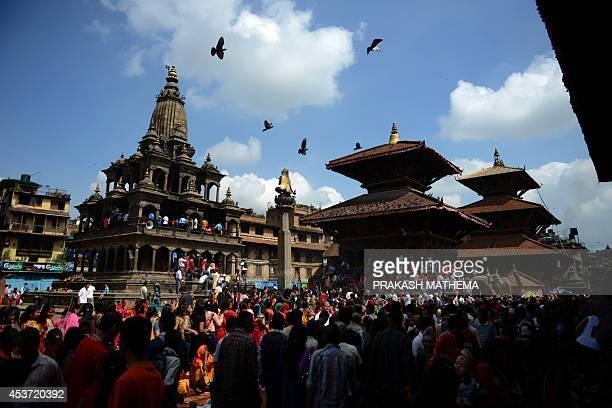 Nepalese Hindu devotees gather to celebrate the birth of Hindu Lord Krishna 'Krishna Janmashtami' at Lalitpur on the outskirts of Kathmandu on August...
