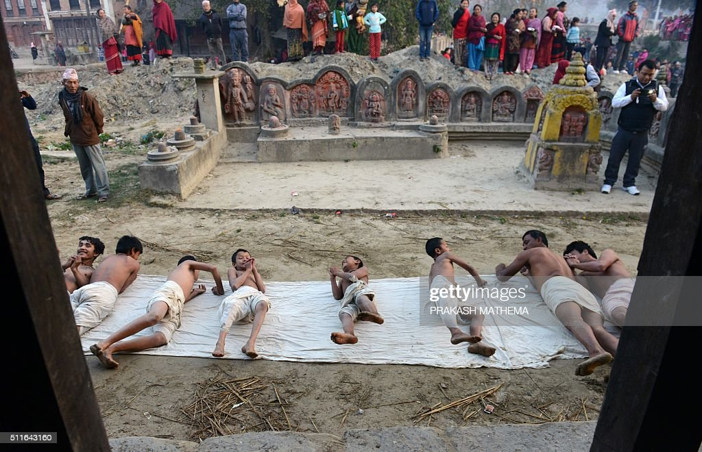 Nepalese hindu devotees offer prayers by rolling on the