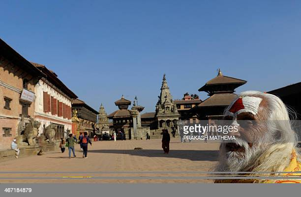 A Nepalese Hindu holy man or sadhu looks on at the Bhaktapur Durbar Square area in Bhaktapur some 12 kilometres southeast of Kathmandu on February 6...