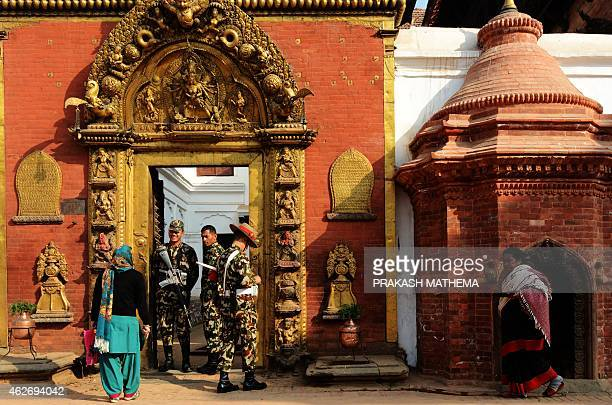A Nepalese Hindu woman leaves a temple in Durbar Square in Bhaktapur some 12 kms southeast of Kathmandu on February 3 2015 Bhaktapur a UNESCO World...