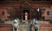 A Nepalese Hindu woman leaves the temple after worship at Patan Durbar square in Lalitpur on June 10 2013 Lalitpur's Durbar Square a UNESCO World...
