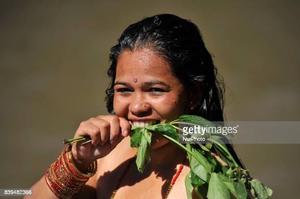 Nepalese Hindu woman performing rituals at the Bagmati River of Pashupatinath Temple during Rishi Panchami Festival celebrations at Pashupatinath...