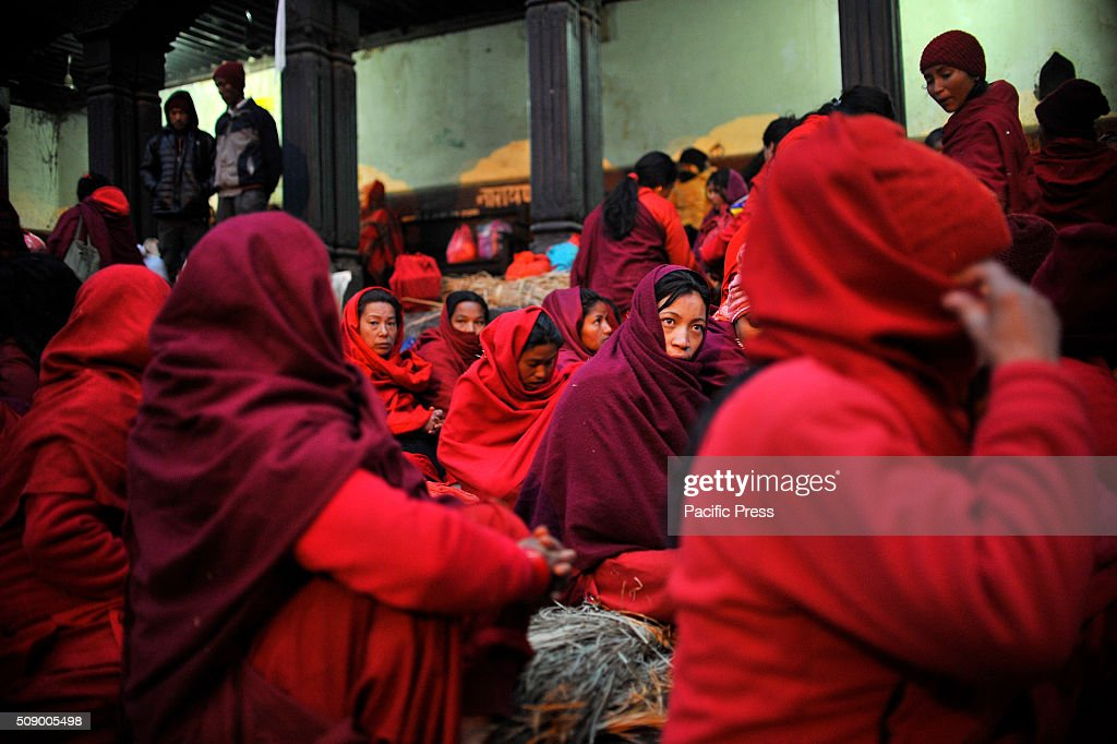 KATHMANDU, NEPAL, KATHMANDU, NP, NEPAL - : Nepalese Hindu women arrive for the holy bath at Pashupathnath Temple. Nepalese Hindu women fast and pray to Goddess Swasthani for Long life of their husbands and family prosperity during the month-long fasting festival celebration.
