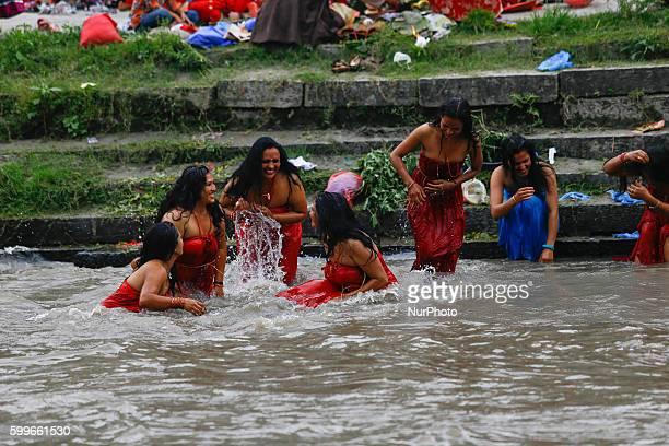 Nepalese Hindu women perform ritual bath in the Bagmati River during the Rishi Panchami festival in Kathmandu Nepal September 6 2016 Rishi Pancham is...