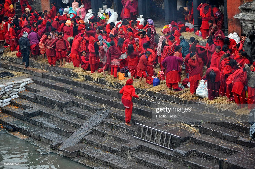 KATHMANDU, NEPAL, KATHMANDU, NP, NEPAL - : Nepalese Hindu women prepare to take holy bath at Pashupathnath Temple. Nepalese Hindu women fast and pray to Goddess Swasthani for Long life of their husbands and family prosperity during the month-long fasting festival celebration.