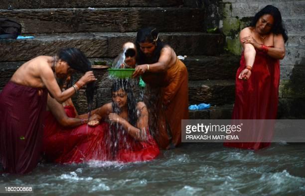 Nepalese Hindu women take a ritual bath in the Bagmati river during the Rishi Panchami festival in Kathmandu on September 10 2013 Rishi Panchami...