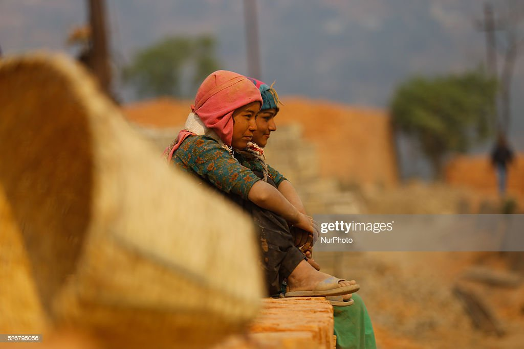 Nepalese laborers carry bricks at a brick factory at Bungamati, on the outskirts of Kathmandu, Nepal, May 1, 2016. Seasonal migrant laborers from neighboring country and rural Nepal comes to Kathmandu valley every year to work at the brick factories.