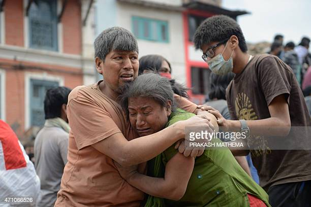 A Nepalese man and woman hold each other in Kathmandu's Durbar Square a UNESCO World Heritage Site that was severely damaged by an earthquake on...