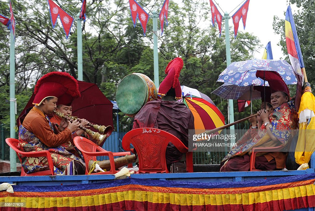 Nepalese monks playing instruments on a truck take part in a procession to mark the 9th International Everest Day in Kathmandu on May 29, 2016. Nepal marks May 29 as International Everest (Sagarmatha) Day, in memory of its first successful ascent on May 29, 1953 by Edmund Hilary and Tenzing Norgay. / AFP / PRAKASH