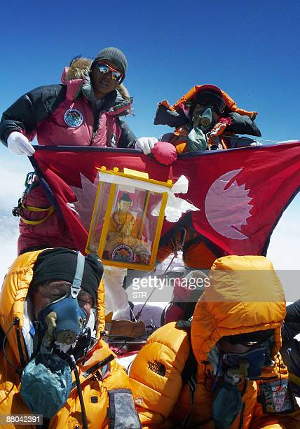 Nepalese mountaineer Pemba Dorje Sherpa who currently holds the record for the fastest ascent of Everest at eight hour and 10 minutes unfurls a...