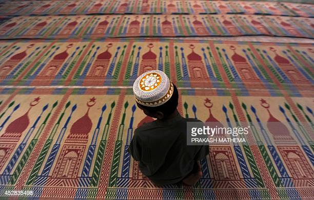 A Nepalese Muslim boy preforms the JummatUlVida the last Friday prayers ahead of the Eid alFitr festival during the month of Ramadan at the Kashmiri...