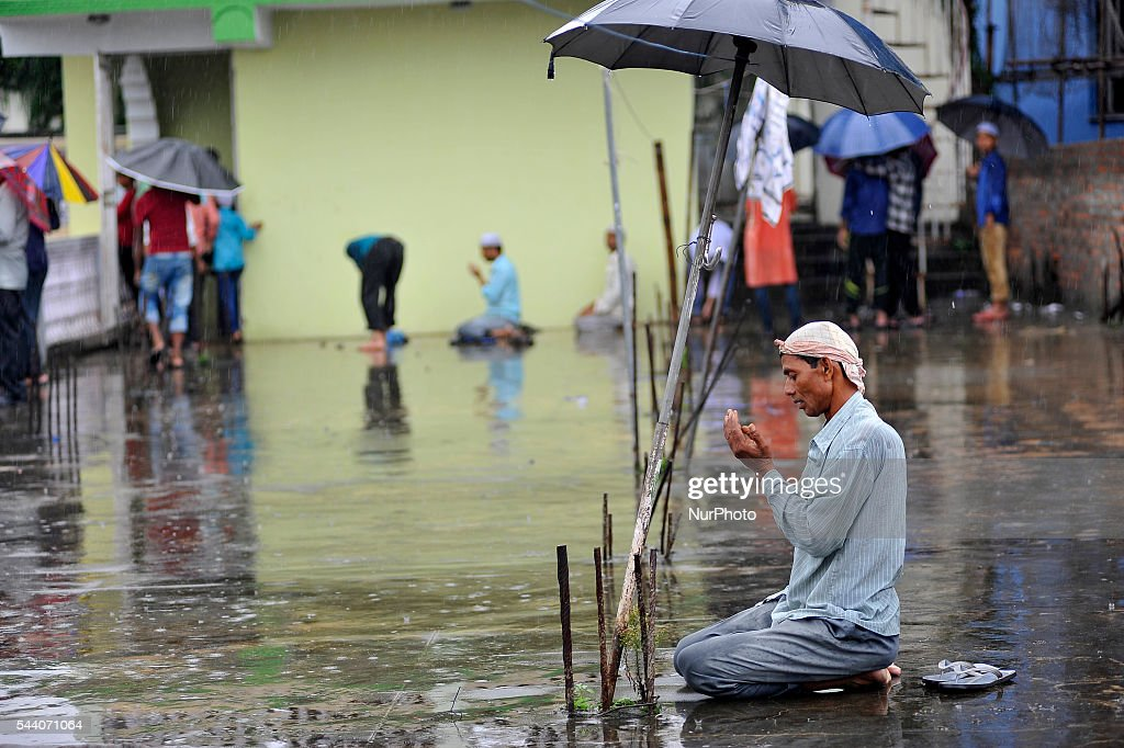 Nepalese Muslim offering Ritual Prayer on Last Friday of Ramadan on a monsoon rain at Kashmari Jame mosque at Kathmandu on July 1, 2016. Ramadan (also known as Ramadhan or Ramzan) is the ninth month in the Islamic calendar. During the month of Ramadan; Muslims fast from dawn to dusk all over the world. While fasting from dawn until sunset; Muslims avoid from consuming food; drinking liquids; smoking; and engaging in sexual relations.