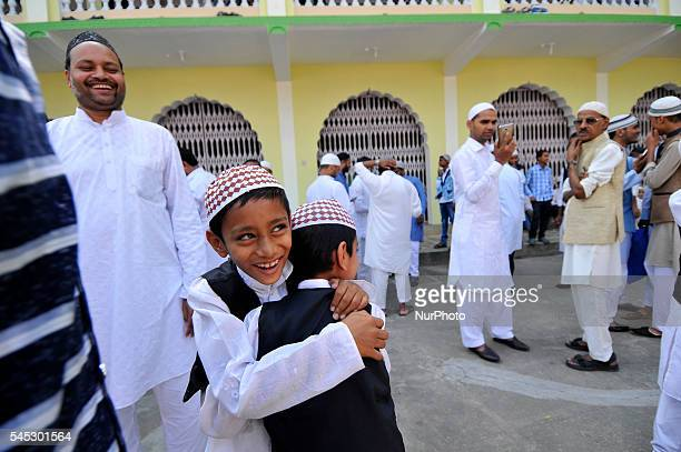 Nepalese Muslims kids hug each other after offering ritual morning prayers during celebration of Eid alFitr on July 7 2016 in Kashmire Jame Mosques...