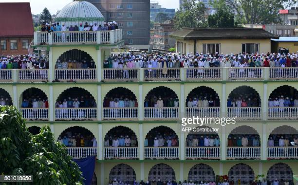 TOPSHOT Nepalese Muslims offer Eid prayers at the start of the Eid alFitr holiday marking the end of Ramadan at the Kashmiri Mosque in Kathmandu on...
