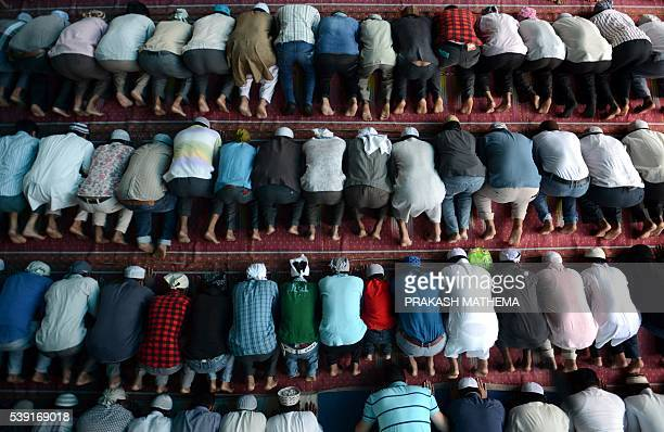 TOPSHOT Nepalese Muslims offer prayers on the first Friday of Ramadan at Kashmiri Mosque in Kathmandu on June 10 2016 Islam's holy month of Ramadan...