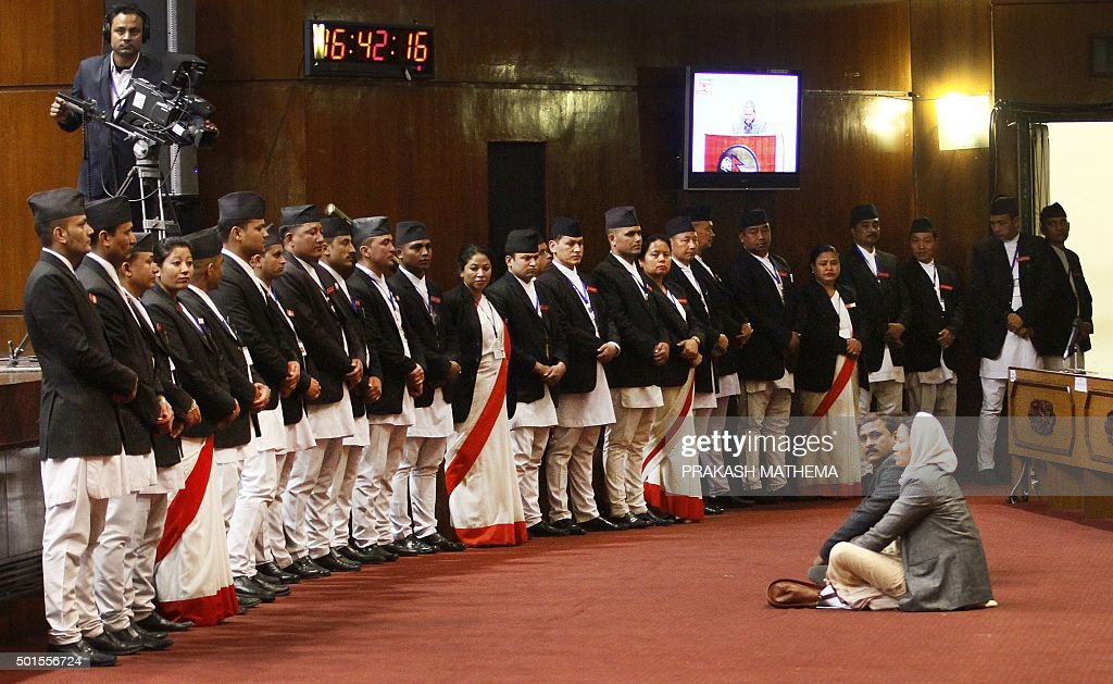 Nepalese Parliamentarians stage a protest as others vote to pass a longdelayed bill in Kathmandu on December 16 2015Nepal's parliament passed...