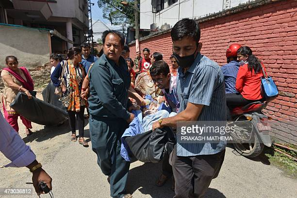 Nepalese patients are carried out of a hospital building as a 74 magnitude earthquake hits the country in Kathmandu on May 12 2015 A 74magnitude...