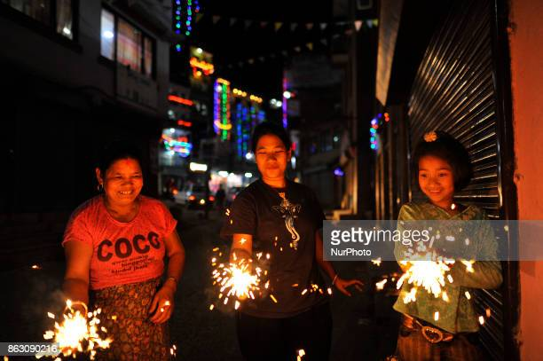 Nepalese people holding beautiful sparklers in hands during Laxmi Puja as the procession of Tihar or Deepawali and Diwali celebrations at Kathmandu...