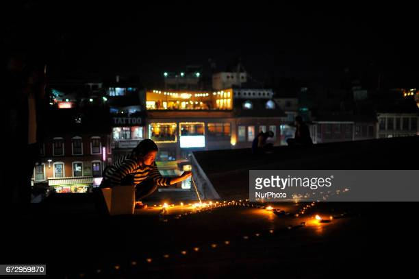 Nepalese people pays homage towards Earthquake victims on Second Anniversary by lighting up candles at Boudhanath Stupa Kathmandu Nepal on April 25...
